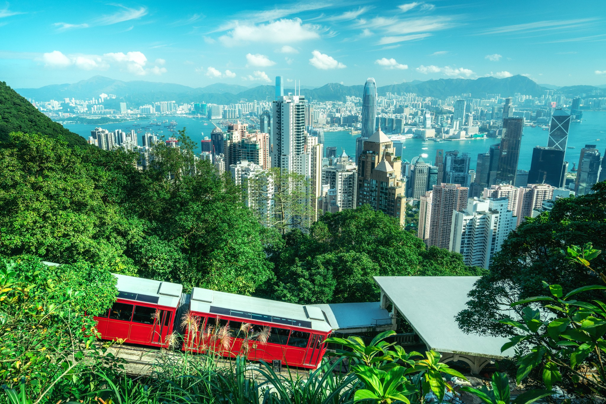 Visiting Hong Kong, China — our top things to do in Hong Kong include visiting Victoria's Peak, Tian Tan Buddha, Hong Kong Waterfront, Hong Kong Beach, Hong Kong Shopping Markets, and Bruce Lee's Hong Kong home.